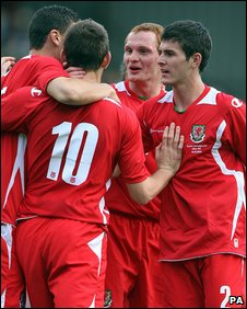 Ched Evans (No 10) is congratulated after opening the scoring