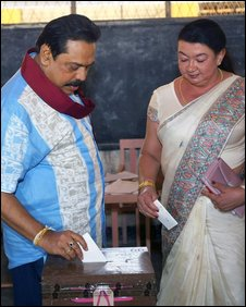 Mahinda Rajapakse and his wife Shiranthi vote in Beliatta, 10 October (Handout: Presidential office)