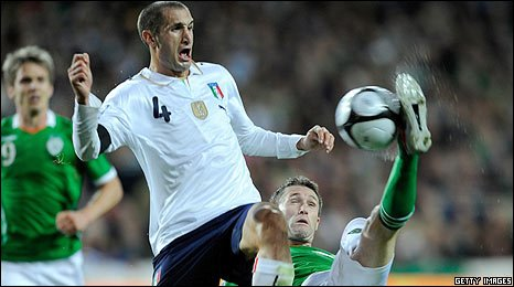 Giorgio Chiellini of Italy moves in as Republic of Ireland captain gets to the ball at Croke Park