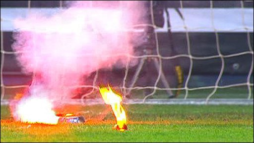 Flares disrupt England defeat in Ukraine