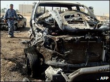 A burnt out car in Ramadi, 11 Oct
