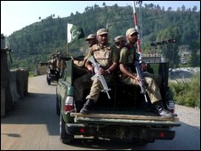 Pakistan army soldiers patrol in Matta in Pakistan's Swat Valley, on 26 September 2009