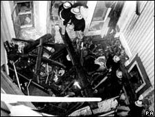 Firefighters work on the scene of the bomb