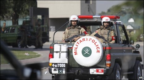Pakistani military police enter the army HQ in Rawalpindi, 11 Oct