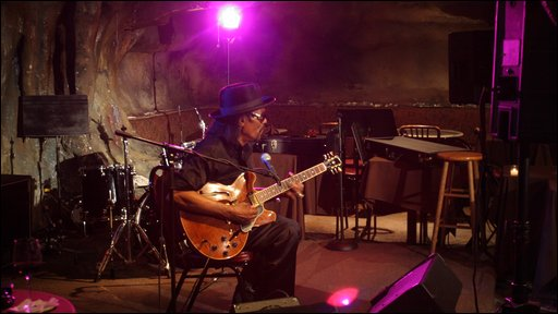 Chuck plays the guitar at Bohemian Caverns
