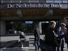Reporters wait outside the Dutch central bank