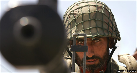 A Pakistani army soldier mans a machine gun near Wana in South Waziristan in April 2007