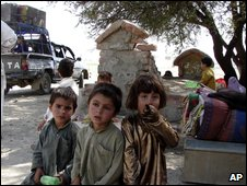 Pakistani tribal families from South Waziristan area fleeing their hometown on  29 September 2009