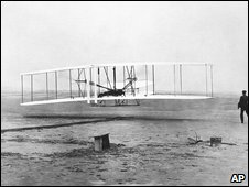 Orville Wright at the controls of the Wright Flyer, North Carolina, 17 December 1903