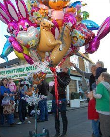 A balloon seller at Pack Monday