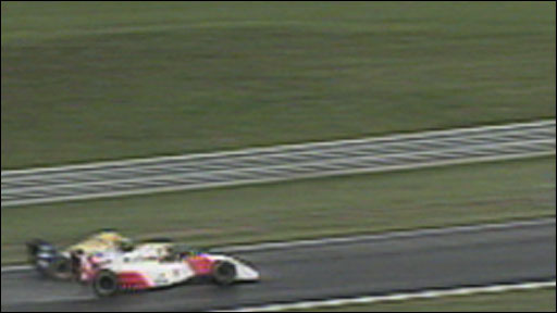 Ayrton Senna gets past Damon Hill