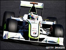 Jenson Button drives an F1 car