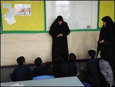 Children being taught in a madrassa
