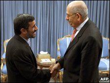 Iranian President Mahmoud Ahmadinejad shakes hands with IAEA chief Mohamed ElBaradei in Tehran on 4 October 2009