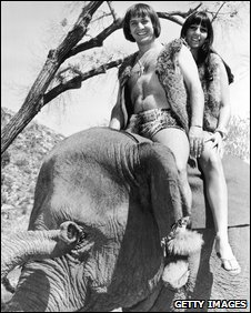Sonny and Cher pose as caveman and woman