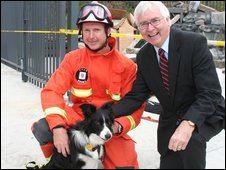 MP Bob Russell, Darcy the rescue dog and handler John Ball