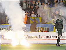 Flares were thrown on to the pitch during England's match against Ukraine in Dnipropetrovsk