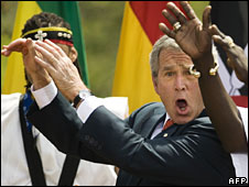 President George W Bush with a West African dance company at the White House, Apr 2007