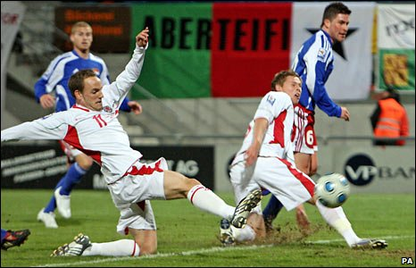 David Vaughan slides in for his first Wales goal
