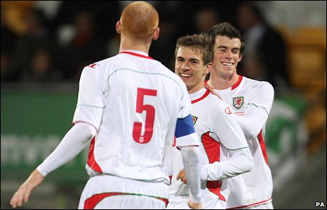 Aaron Ramsey (centre) is congratulated on his fist international goal