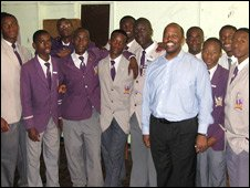 Peter Ndoro with pupils at his old school