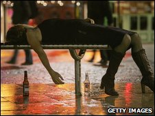 Drunk woman lies on a bench in Bristol