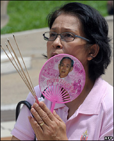Woman prays for King Bhumibol Adulyadej
