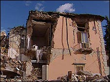 Partly-destroyed house in L'Aquila