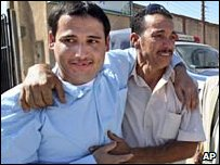 A released inmate (left) in greeted by his relative near Tripoli