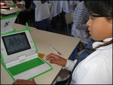 child with XO laptop