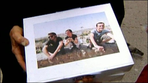 Box containing petition features picture of the three American hiker release