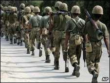 Pakistan army troops arrive at a police training school raided by gunmen in Lahore, Pakistan, Thursday, Oct. 15, 2009