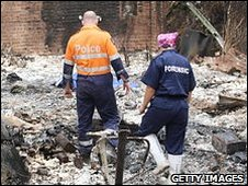 Surveying a house destroyed by bush fires in Victoria, February 2009