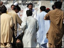An injured person is carried away from the scene of Friday's attack