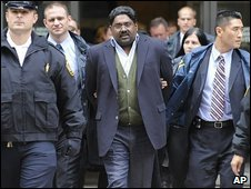 Hedge fund founder Raj Rajaratnam is led away by FBI agents in New York, 16 October 2009