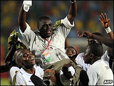 Sellas Tetteh is raised aloft by Ghana's winning players