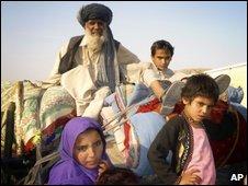 A family flee Waziristan region near the Afghan border ahead of fighting