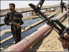 Iraqi officers secure an oil pipeline from the Rumaila oil refinery, near Basra, Iraq, file pic from 2008