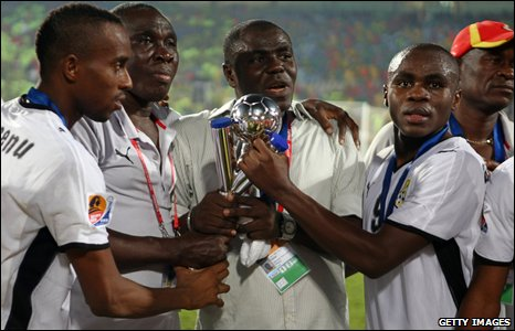 The Ghanaian team and staff celebrate their win