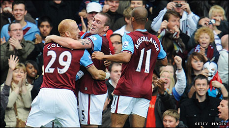 James Collins, Richard Dunne and Gabriel Agbonlahor celebrate Villa's winner