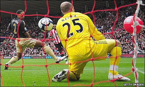 Liverpool keeper Pepe Reina is beaten after Darren Bent's shot deflected in off a bech ball (right)