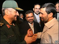 Mohammad Ali Jafari shakes hands with President Mahmoud Ahmadinejad
