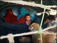 A Pakistani family who fled the fighting wait for clearance in Dera Ismail Khan