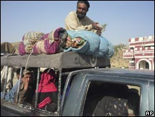A Pakistani family from South Waziristan at a checkpoint on the outskirts of Dera Ismail Khan on Sunday, Oct. 18, 2009