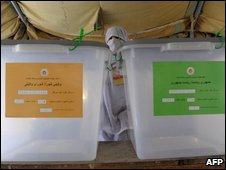 "A file photo taken August 20, 2009 shows an Afghan electoral worker waiting for voters beside empty ballot boxes at a school converted to a polling centre in Kandahar. Afghanistan""s UN-backed Electoral Complaints Commission (ECC}"