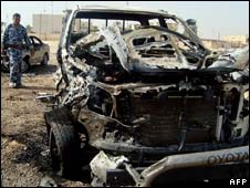 Aftermath of a car bomb attack in Ramadi, western Iraq, on 11 October