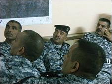 Iraqi police at briefing