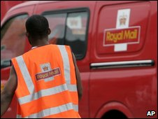 Royal Mail worker and van