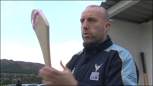 Scotland international shinty coach Fraser Mackenzie with a hurler