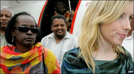 Aid workers Hilda Kawuki (L) and Sharon Commins (R) arrive in Khartoum airport after their release in Darfur
